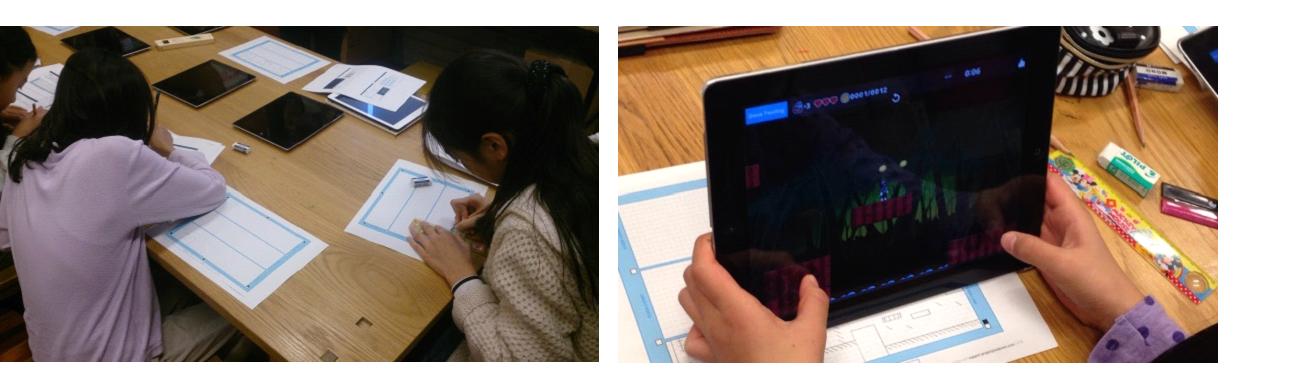 児童が実験に参加し、ゲームを作成している様子